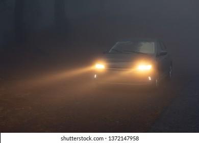 Arafo, Santa Cruz de Tenerife / Spain - 10 22 2018:  car headlight beams in dense mist