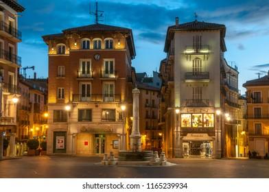 Aragon, Spain - december 04, 2010: Ancient buildings lit at dusk in the Plaza de Carlos Castel in the city of Teruel