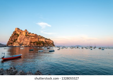 Aragonese castle, bay and boats. Ischia, Italy. Copy space.
