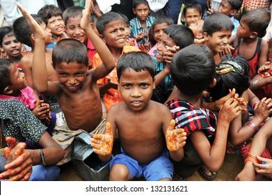 ARAKAN, BANGLADESH - AUGUST 20: Bangladeshi refugee children and women from Arakan go through a hard time in camps. on August 20, 2012 in Arakan, Bangladesh.
