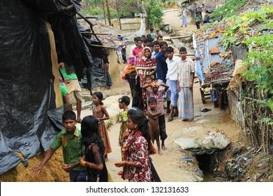 ARAKAN, BANGLADESH - AUGUST 20: Bangladeshi refugee children and women from Arakan go through a hard time in camps, on August 20, 2012 in Arakan, Bangladesh.