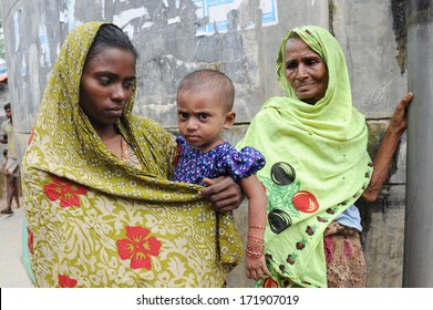 ARAKAN, BANGLADESH - AUGUST 20: Bangladeshi refugee child and women from Arakan go through a hard time in camps, on August 20, 2012 in Arakan, Bangladesh.
