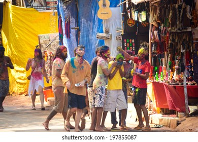 ARAMBOL, GOA, INDIA - MARCH 17: Unidentified people celebrates Holi festival in Arambol Main Street, GOA, India March 17, 2014. It's a religious spring holiday and also known as Festival of Colours.