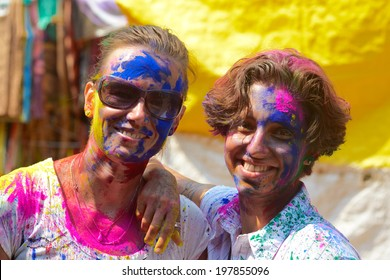 ARAMBOL, GOA, INDIA - MARCH 17: Young women celebrates Holi festival in Arambol Main Street, GOA, India March 17, 2014. It's a religious spring holiday and also known as Festival of Colours.