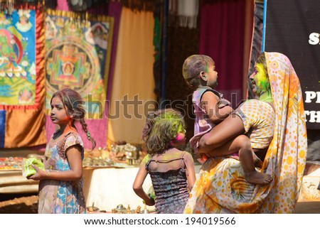 ARAMBOL, GOA, INDIA - MARCH 17: Unidentified people celebrates Holi festival in Arambol Main Street, GOA, India on March 17, 2014. It's a religious spring holiday and also known as Festival of Colours.