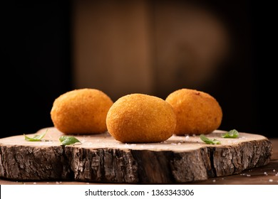 Arancini di riso, fried risotto rice balls, italian sicilian food close up