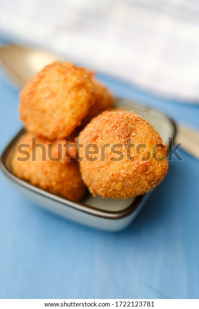 Arancini fried risotto balls in a bowl ready to be eaten