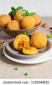 Arancini - italian rice balls which are coated with bread crumbs and then deep fried, filled with ragu (meat and tomato sauce) and peas.
