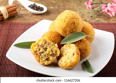 Arancini rice and meat on complex background