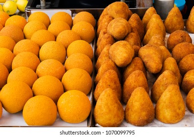 Arancini of rice: sicilian street food. Rice balls stuffed with meat cooked.