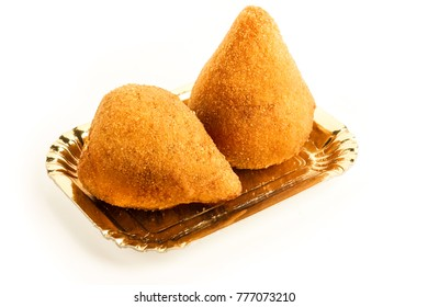 Arancini of rice, typical Sicilian street food on a golden tray.