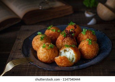Arancini: traditional Italian rice and parmesan balls stuffed with fresh mozzarella
