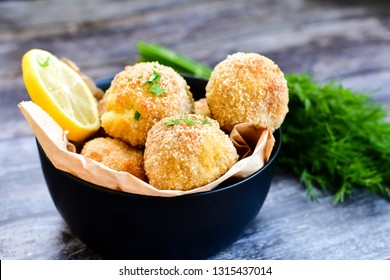 Arancini. Traditional Italian rice and parmesan balls stuffed with fresh mozzarella