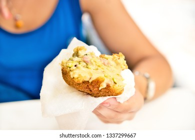 An arancino, the typical sicilian street food made of saffron rice, meat and pistachio in a fried breaded ball