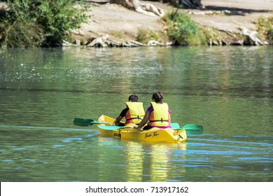 Aranjuez, Madrid, Spain. September 10, 2017. Two people practice kayaking by the Tagus river in Aranjuez, Spain.