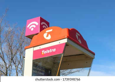 ARARAT, AUSTRALIA – July 6, 2019: Telstra pay phone kiosk with a pink Telstra Air wifi hotspot sign on top
