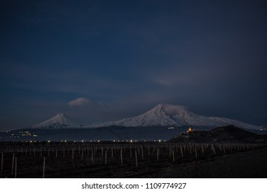 Ararat mountain at night with Khor Virap ancient foretress and church. Concept of travel, freedom and roadtrip. Toned with soft old fashioned sepia colors.