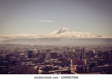 Ararat mountain seen from Yerevan - the capital of Armenia. Toned with soft old fashioned sepia colors. Concept of travel, exploration and tourism.