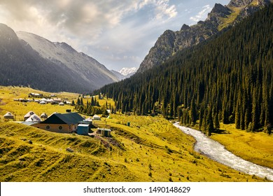 Arashan river and guest houses with yurt in the mountain valley of Altyn Arashan gorge, Kyrgyzstan