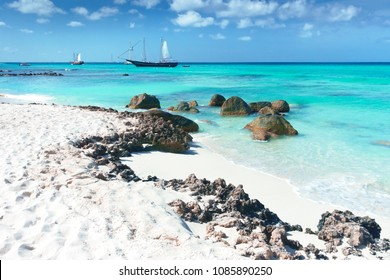 Arashi Beach, Aruba, Caribbean Sea: 2 tour boats anchored for tourists to go swimming or snorkeling in the turquoise water.