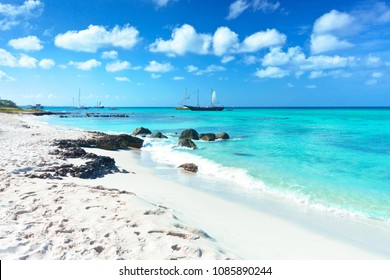 Arashi Beach, Aruba, West Indies: tour boat anchored near the shore for tourists to go swimming or snorkeling in the turquoise water.