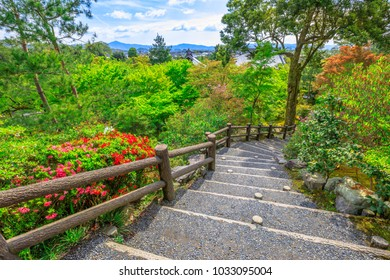Arashiyama city panorama and aerial view of Tenryu-ji Zen Temple on the hill above the temple in the mountains on western outskirts of Kyoto, Japan. Garden path of a hundred flowers or Hyakka'en.