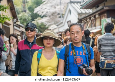 ARASHIYAMA, JAPAN - APRIL 4, 2013: Japanese tourists explore Arashiyama in the outskirts of Kyoto, Japan. Arashiyama has been a popular destination during cherry blossom since the 8th century.