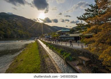 ARASHIYAMA, KYOTO, JAPAN - April 11, 2019 : People explore the Arashiyama area, along the Katsura river, Arashiyama, Kyoto, Japan.
