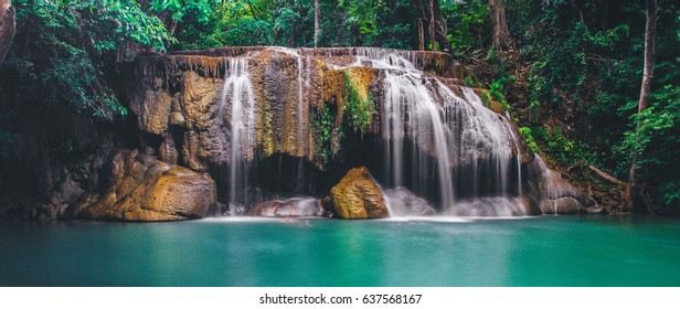 Arawan waterfall in tropical forest Thailand,leaf moving low speed shutter blur,Waterfall in forest of kanchanaburi,Deep forest Waterfall in Kanchanaburi, Thailand,Motion blur of water