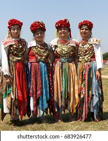 Arbanassi, Bulgaria - July 22, 2017: Woman in traditional folklore costumes on National folklore fair in the village of Arbanassi, Bulgaria