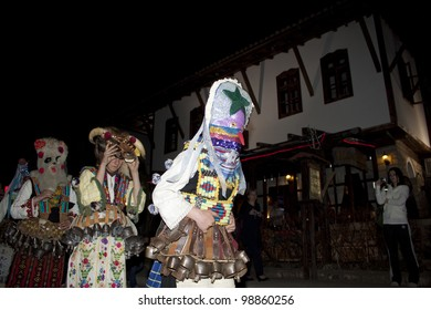 """ARBANASSI, BULGARIA - MARCH 24: Kukeri dance group perform a dance to ward away bad spirits during """"Blagoveshtenie"""", a Bulgarian holiday, on March 24, 2012 in Arbanassi, Bulgaria."""