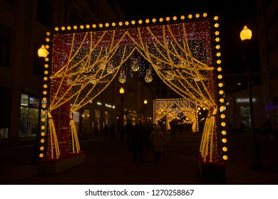 Arbat street, Moscow, Russia - January 10th 2018 - Beautiful colorful Christmas/ New Year holidays light installations/ decorations at the Arbat street in city center in the evening. editorial.