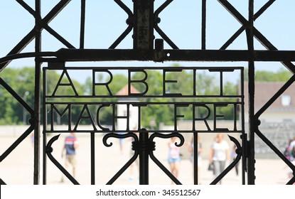 Arbeit Mach Frei (work liberates) sign at Dachau camp, Germany.