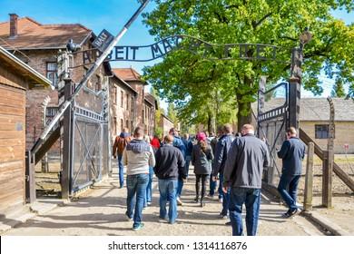 Arbeit macht frei at Auschwitz I. Auschwitz, Birkenau. Poland. September 2018. Visitors in concentration camp. Tourists Taking Photos at Auschwitz Concentration Camp with Arbeit Macht Frei