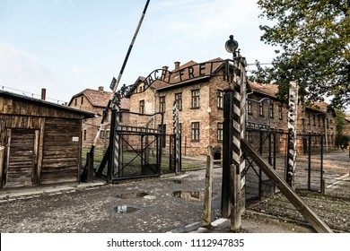 """Arbeit macht frei"" sign on the main entrance gateway to Auschwitz-Birkenau (Auschwitz I) concentration camp near Oswiecim city, Poland. This German phrase meaning ""Work sets you free"""