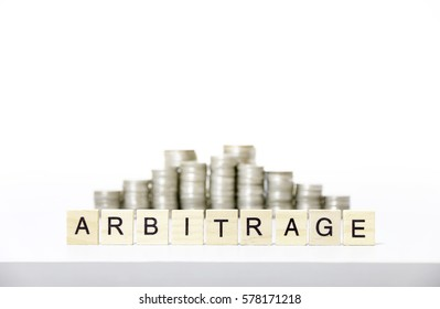 ARBITRAGE text made with wood blocks.Business Concept .