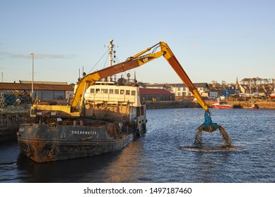 Arbroath, Scotland - 26th February 2015: The Shearwater Dredger operating in the Outer Harbour at Arbroath, removing Silt and mud from the Harbour Floor.