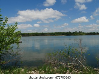 Arbuckle Lake on a bright sunny day, Oklahoma Blue and white skies reflected in the clear blue waters of Arbuckle Lake, Oklahoma