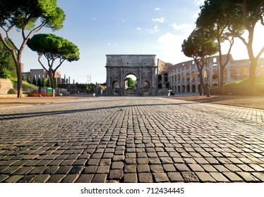 Arc of Constantin and Colosseum in Rome at sunrise, Italy.