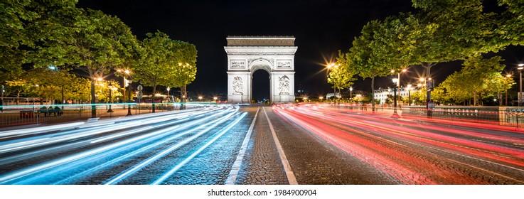 Arc de Triomphe and Champs Élysée panorama at night, Paris, France