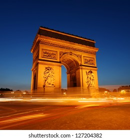 Arc de Triomphe and Champs-Elysees Avenue at night, in Paris, France