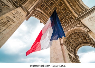 Arc de Triomphe with flag of France