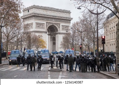 "Arc De Triomphe and heavy police force during the ""Yellow Vests"" antigovernment protest in the French capital. Paris, France - December 8, 2018"