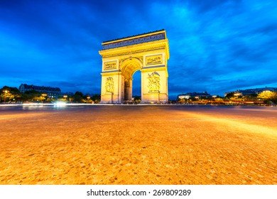 Arc de Triomphe illuminated at night, Paris.