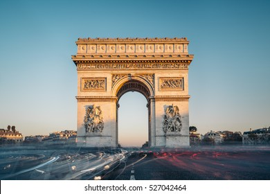 The Arc de Triomphe de l'Etoile (Triumphal Arch of the Star) at sunset. It is one of the most famous monuments in Paris, standing at the western end of the Champs-Elyseees.
