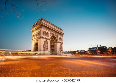 The Arc de Triomphe de l'Etoile (Triumphal Arch of the Star) at Night. It is one of the most famous monuments in Paris, standing at the western end of the Champs-Elyseees.