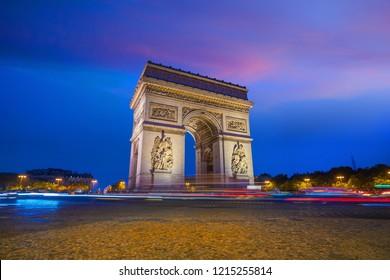 Arc de Triomphe located in Paris, France at twilight