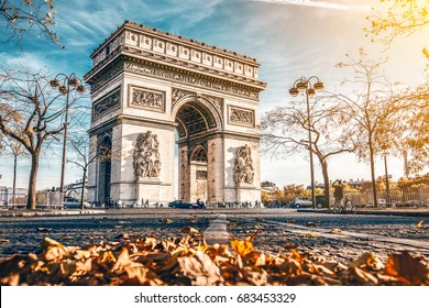Arc de Triomphe located in Paris, in autumn scenery.