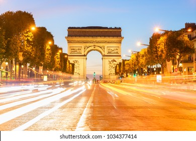 Arc de Triomphe at night with light trails, Paris, France