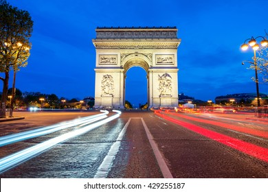 Arc de Triomphe at night in Paris, France.